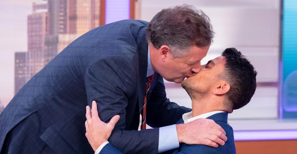 Piers kissing Peter Andre on Good Morning Britain. (REX/Shutterstock)