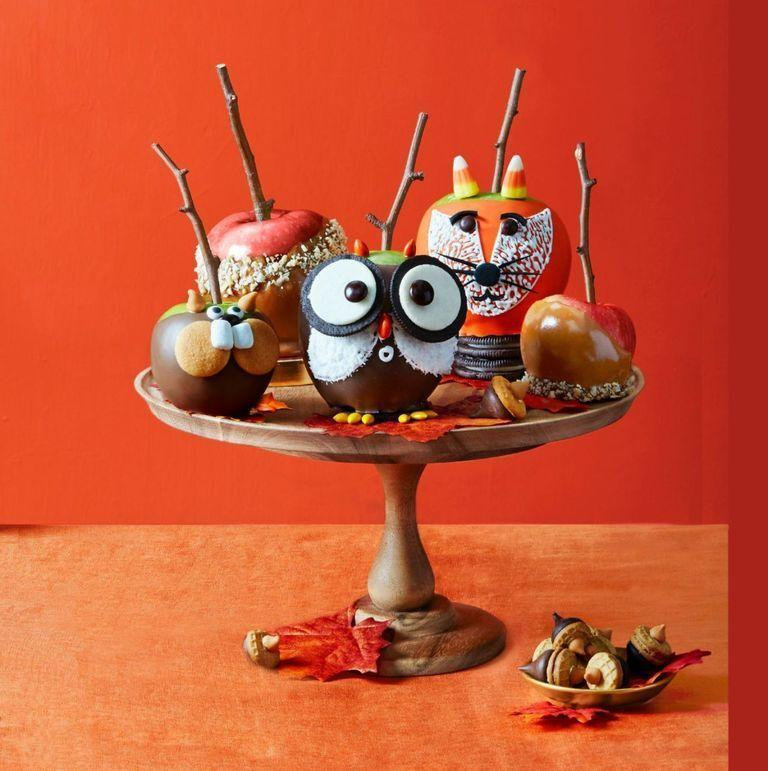 """<p>Use <a href=""""https://www.goodhousekeeping.com/holidays/halloween-ideas/g4630/best-new-halloween-treats/"""" rel=""""nofollow noopener"""" target=""""_blank"""" data-ylk=""""slk:Halloween candy"""" class=""""link rapid-noclick-resp"""">Halloween candy</a> to decorate this this fall-time favorite dessert!</p><p><em><a href=""""https://www.womansday.com/food-recipes/food-drinks/recipes/a52083/candy-apples/"""" rel=""""nofollow noopener"""" target=""""_blank"""" data-ylk=""""slk:Get the recipe from Woman's Day »"""" class=""""link rapid-noclick-resp"""">Get the recipe from Woman's Day »</a></em></p>"""