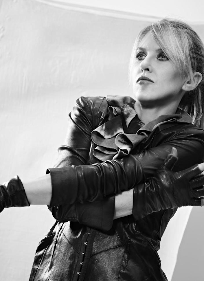A black-and-white portrait of Liz Phair
