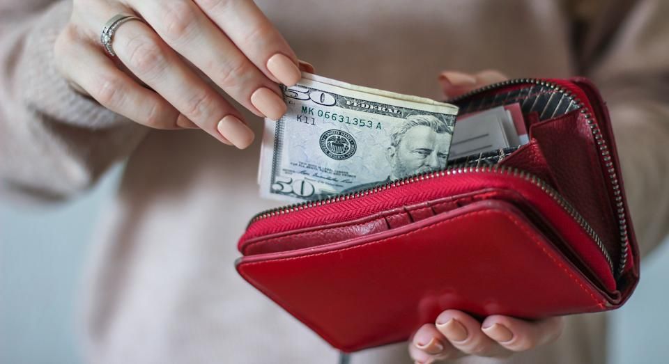 Paying with cash will make millennials think you're old, finds new research. (Getty Images)