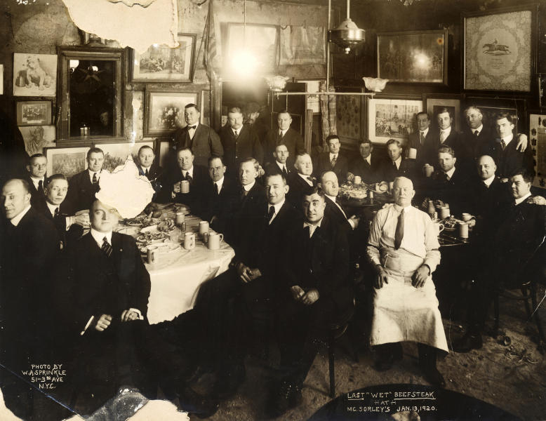 In this Jan. 13, 1920 photo provided by McSorley's Old Ale House, clients and staff pose in the New York bar shortly before the beginning of Prohibition. Located in Manhattan's Lower East Side, McSorley's opened in the mid-19th century, functioned as a speakeasy during Prohibition, and continues in operation today. (W.A. Sprinkle/McSorley's Old Ale House via AP)