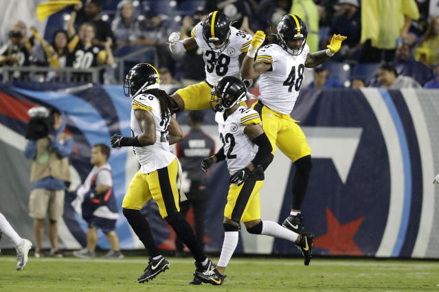 Pittsburgh Steelers defensive back Kam Kelly (38) and outside linebacker Bud Dupree (48) celebrate after Tennessee Titans quarterback Marcus Mariota was sacked in the end zone for a safety in the first half of a preseason NFL football game Sunday, Aug. 25, 2019, in Nashville, Tenn. (AP Photo/James Kenney)