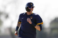 FILE - In this Feb. 19, 2020, file photo, Milwaukee Brewers' Christian Yelich reacts during a spring training baseball workout in Phoenix. The Brewers are reportedly working on a new contract with star slugger Christian Yelich. It's an encouraging sign for Milwaukee after it lost a couple key performers during free agency. (AP Photo/Gregory Bull, File)