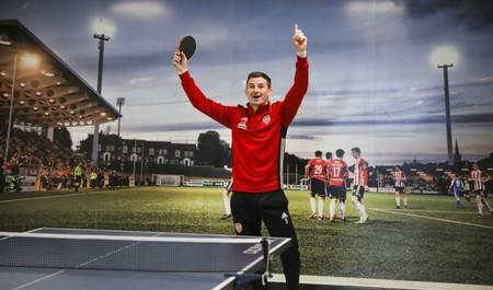 Derry City player Ciaran Coll reacts after winning a game of table-tennis at the club's gym facility in Londonderry, Northern Ireland