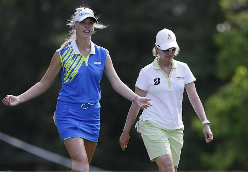 Jessica Korda, left, talks with Karrie Webb of Australia as they walk to the 16th tee during second round play in the Mobile Bay LPGA Classic golf tournament at the Robert Trent Jones Golf Trail at Magnolia Grove in Mobile, Ala. Friday, May 17, 2013. (AP Photo/Dave Martin)