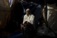 """Tigrayan refugee Maza Girmay, 65, sits in her shelter, in Hamdayet, eastern Sudan, near the border with Ethiopia, on March 15, 2021. """"I heard food was being distributed,"""" she said. She went to the government office in her community of Bahkar to inquire. """"They told me, 'Go home, you're Tigrayan.'"""" The rejection brought her to tears. """"We Tigrayans are Ethiopian. Why do they treat us as non-Ethiopian?"""" she said. (AP Photo/Nariman El-Mofty)"""