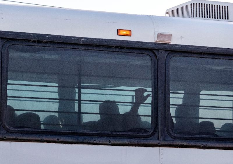 A bus transporting immigrants leaves a temporary facility at a US Border Patrol station in Clint, Texas (AFP Photo/Paul Ratje)