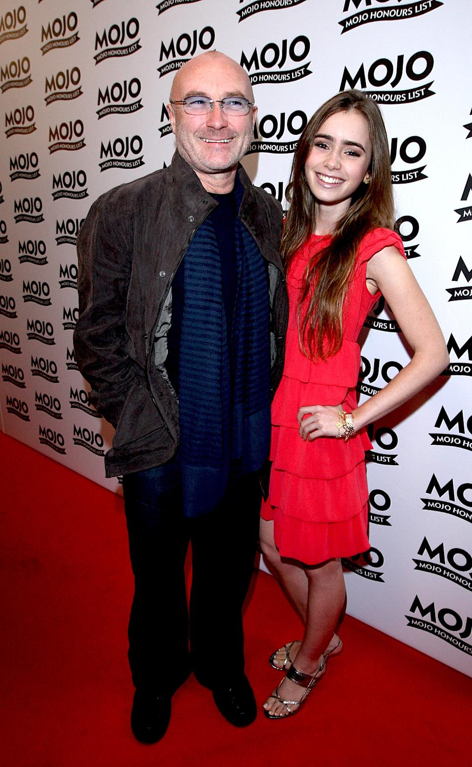 Phil Collins and daughter Lily arrive for the Mojo Honours List award ceremony at The Brewery, east London.