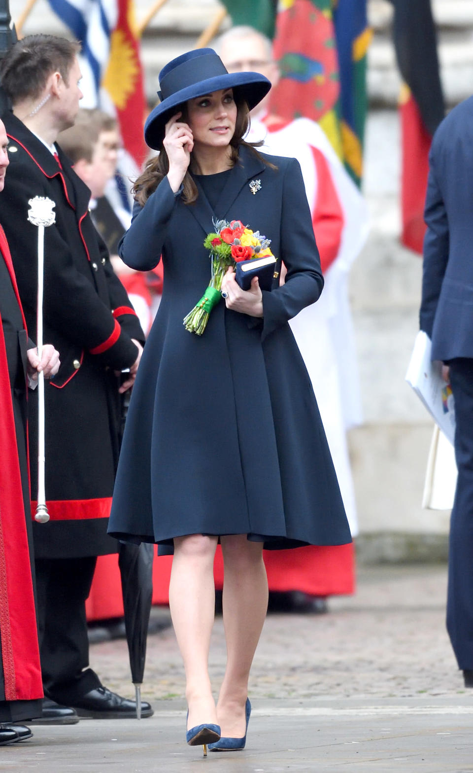 <p><strong>The occassion:</strong> At the 2018 Commonwealth Day service at Westminster Abbey.<br><strong>The look:</strong> A navy Beulah coat wit Rupert Sanderson heels and a Jimmy Choo clutch. <br>[Photo: Getty] </p>