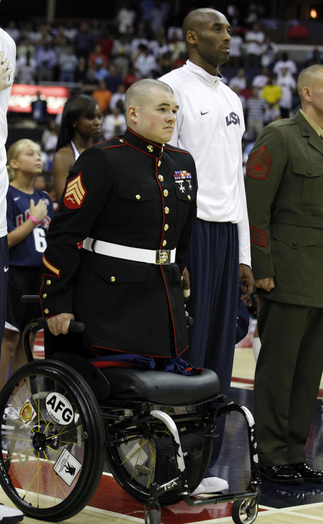 Marine Corps vet Sgt. Zachary Stinson stood using his arms during the national anthem at a 2012 Team USA basketball game. He's back in the news after developing a special friendship with a young fourth-grader in Maine.
