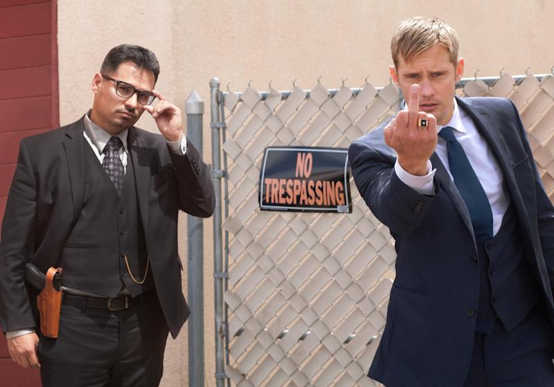 Michael Peña as Detective Bob Bolaño and Alexander Skarsgård as Detective Terry Monroe in 'War On Everyone' - Credit: Icon