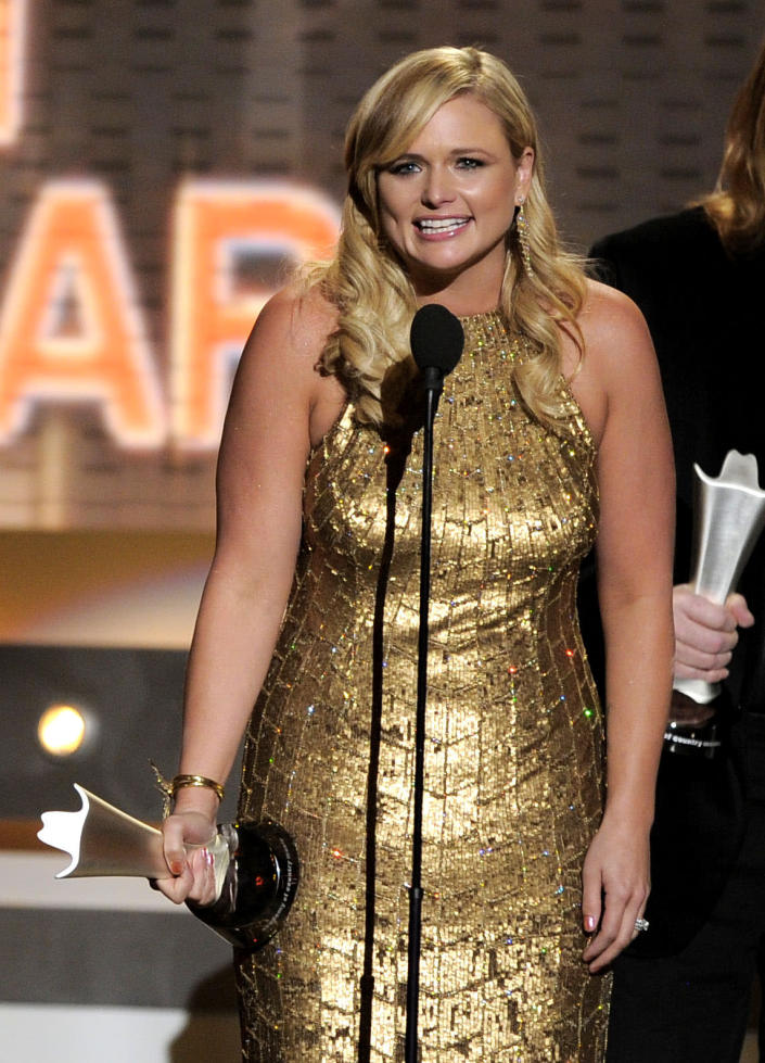 """Miranda Lambert accepts the award for album of the year for """"Four the Record"""" at the 47th Annual Academy of Country Music Awards on Sunday, April 1, 2012 in Las Vegas. (AP Photo/Mark J. Terrill)"""