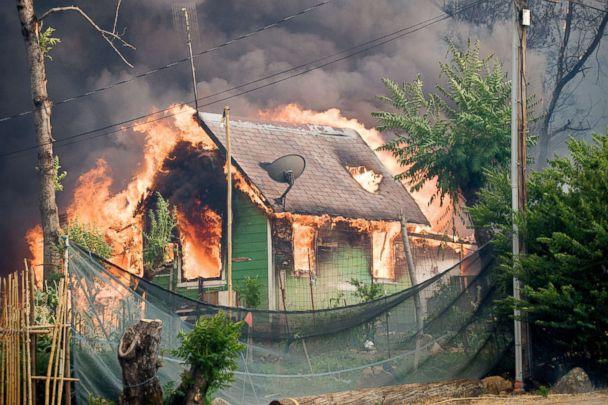 A house burns in the town of Shasta, Calif., after the Carr Fire tore through the town, July 26, 2018. (Mark McKenna via ZUMA )