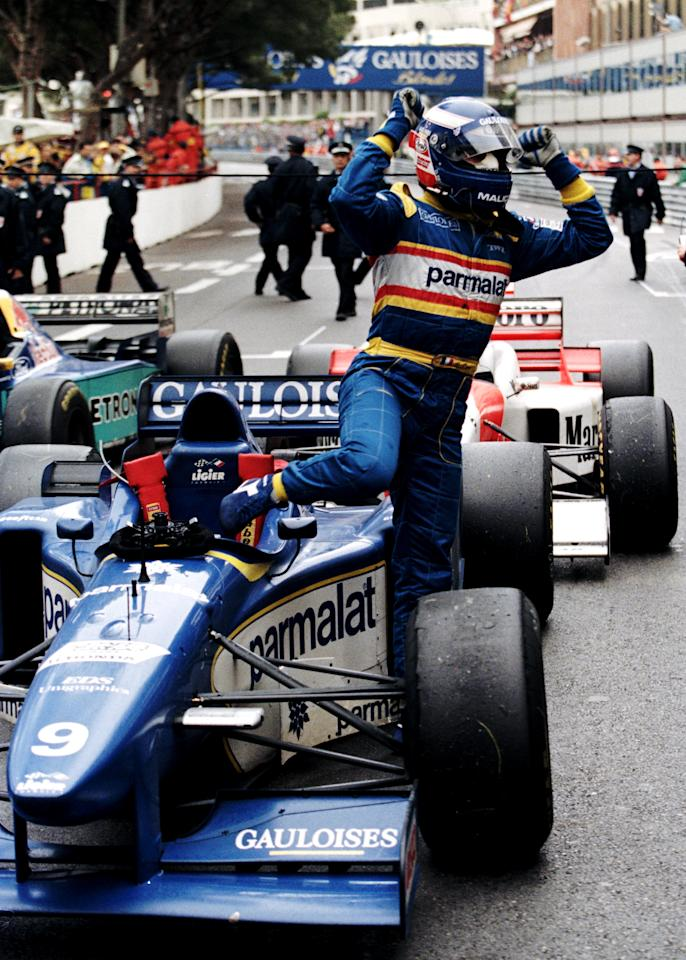 Olivier Panis with arms aloft climbs from his #9 Equipe Ligier Gauloises Blondes Ligier JS43 Mugen-Honda 3.0 V10 to celebrate victory at the Grand Prix of Monaco on 19th May 1996 on the streets of the Principality of Monaco in Monte Carlo, Monaco.(Photo by Pascal Rondeau/Getty Images)
