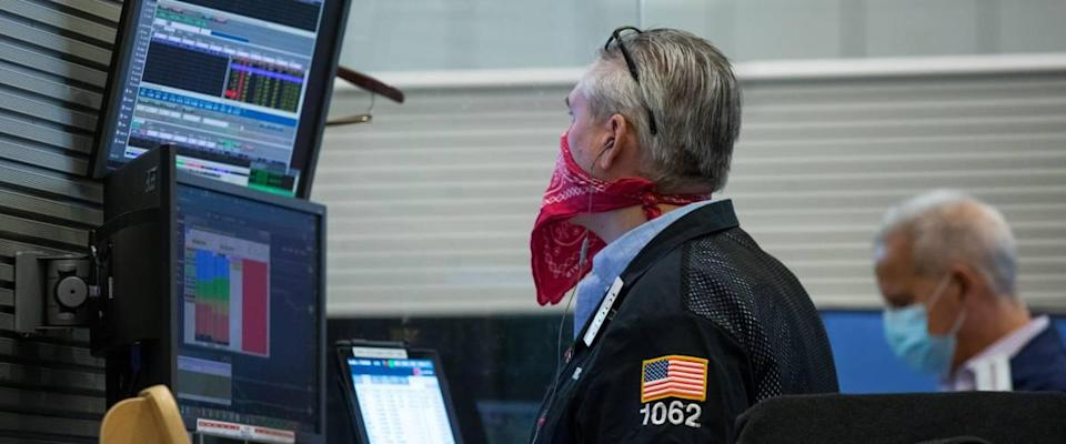 New York Stock Exchange traders in masks