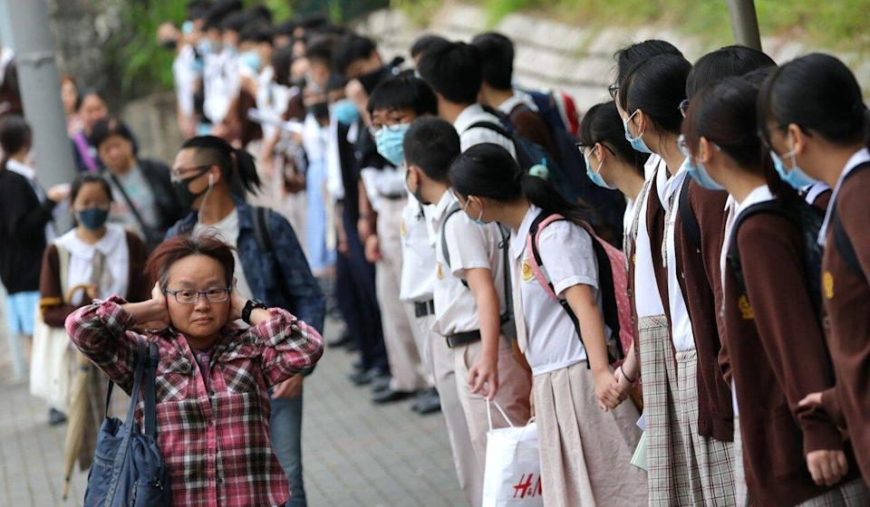 School pupils form a human chain in support of the pro-democracy protest movement in Diamond Hill, Hong Kong, in October 2019. Photo: May Tse