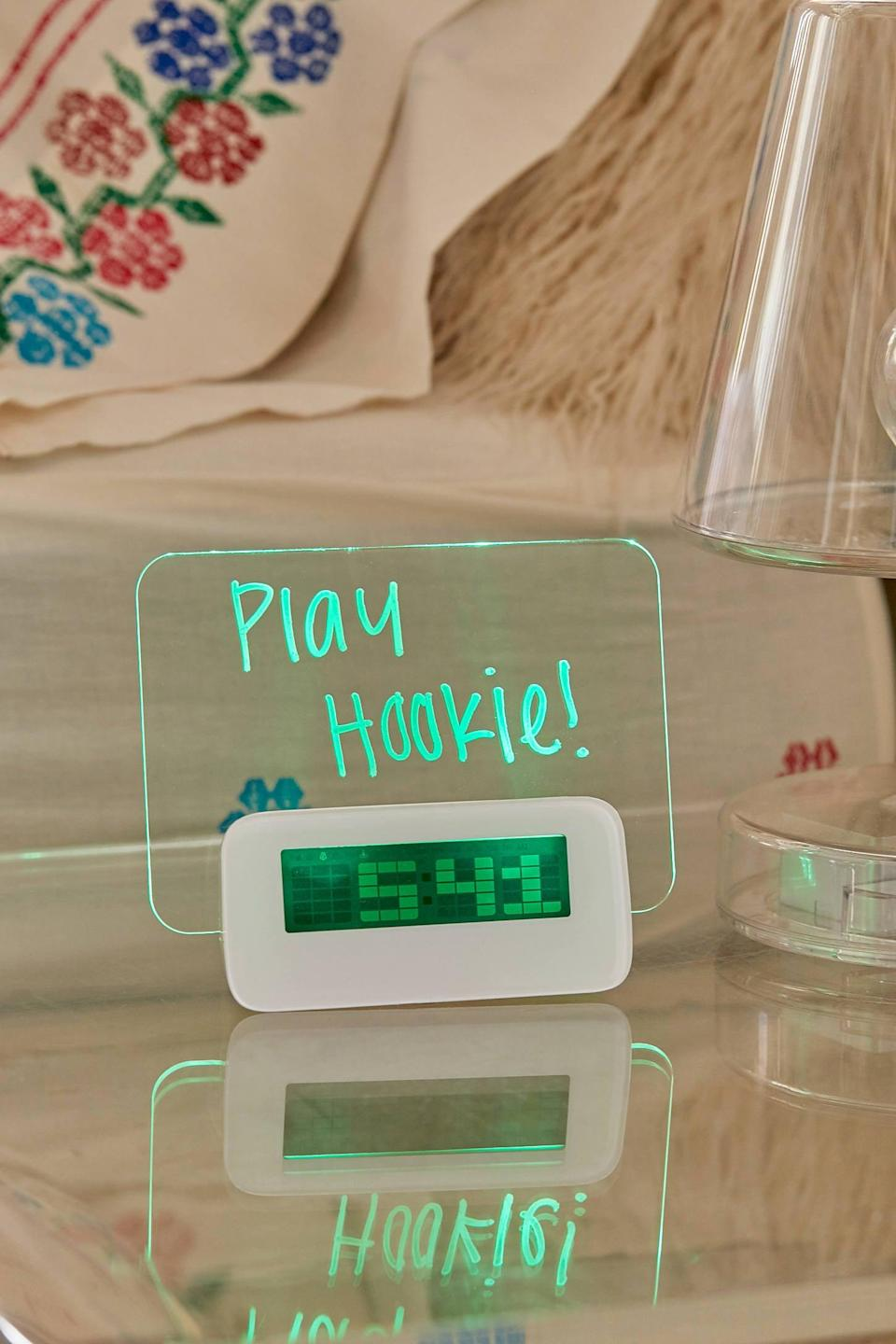 """<p>They can write messages on this <a href=""""https://www.popsugar.com/buy/LED-Scribble-Alarm-Clock-496550?p_name=LED%20Scribble%20Alarm%20Clock&retailer=urbanoutfitters.com&pid=496550&price=20&evar1=geek%3Auk&evar9=26294675&evar98=https%3A%2F%2Fwww.popsugartech.com%2Fphoto-gallery%2F26294675%2Fimage%2F46728677%2FLED-Scribble-Alarm-Clock&list1=shopping%2Cgadgets%2Choliday%2Cgift%20guide%2Choliday%20living%2Ctech%20gifts%2Cgifts%20under%20%24100&prop13=api&pdata=1"""" class=""""link rapid-noclick-resp"""" rel=""""nofollow noopener"""" target=""""_blank"""" data-ylk=""""slk:LED Scribble Alarm Clock"""">LED Scribble Alarm Clock</a> ($20).</p>"""