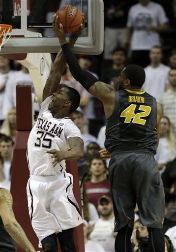 Missouri's Alex Oriakhi (42) tries to block a shot by Texas A&M's Ray Turner (35) during the second half of an NCAA college basketball game on Thursday, Feb. 7, 2013, in College Station, Texas. Texas A&M won 70-68. (AP Photo/Pat Sullivan)