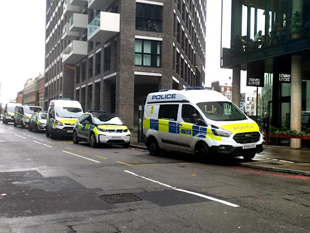 Police at the scene on Buckle Street, Whitechapel, east London, after a man died and another three were injured following a stabbing. (PA)