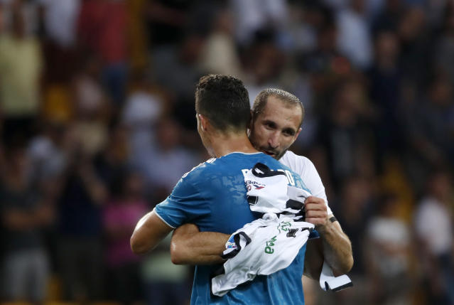 Juventus' Cristiano Ronaldo, front, celebrates with Juventus' Giorgio Chiellini at the end of the Serie A soccer match between Parma and Juventus at the Tardini stadium, in Parma, Italy, Saturday, Aug. 24, 2019. (AP Photo/Antonio Calanni)