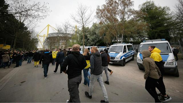 "Fans were held back at Signal Iduna Park after Borussia Dortmund's defeat to Monaco, allowing police to clear ""suspicious objects""."