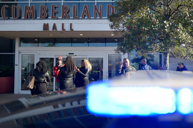 Bystanders wait outside as authorities investigate an incident at Cumbnerland Mall in Smyrna, Ga., on Saturday, Dec. 14, 2019. (AP Photo/Mike Stewart)