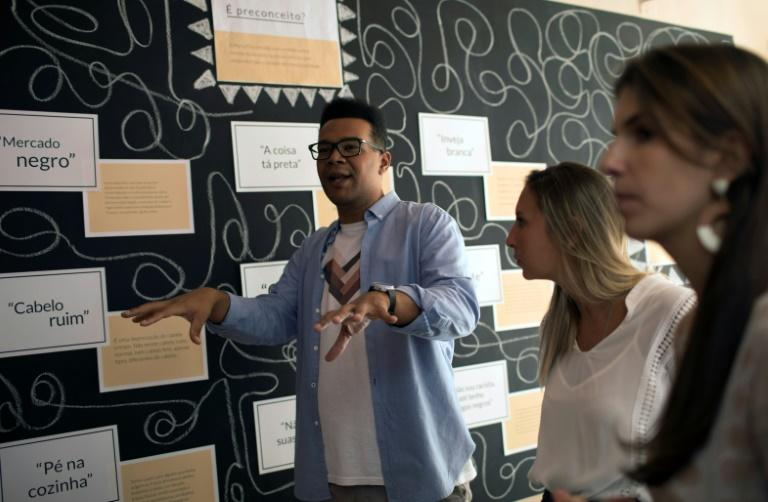 Esteban Cipriano, in charge of education programs at the anti-racism group ID_BR, talks to employees of the fashion brand Maria Filo in Rio de Janeiro, Brazil, on November 17, 2017