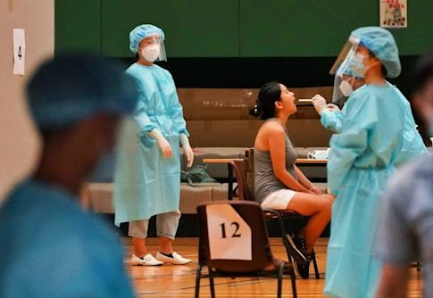 A resident takes the test at Yuen Wo Road Sports Centre in Sha Tin. Photo: Felix Wong