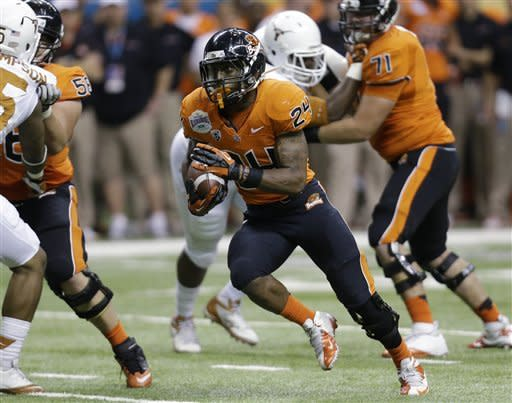 Oregon State's Storm Woods (24) rushes for a touchdown against Texas during the first quarter of the Alamo Bowl NCAA football game, Saturday, Dec. 29, 2012, in San Antonio. (AP Photo/Eric Gay)