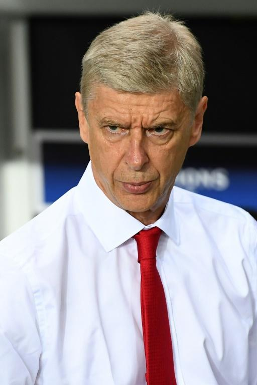Arsenal's manager Arsene Wenger watches their UEFA Champions League Group A match against PSG, at the Parc des Princes stadium in Paris, on September 13, 2016
