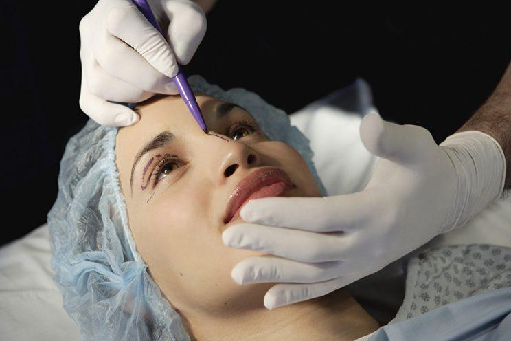 Going under the knife for a facelift may make you look more successful, younger, and healthier, according to a new study. (Photo: Getty Images)