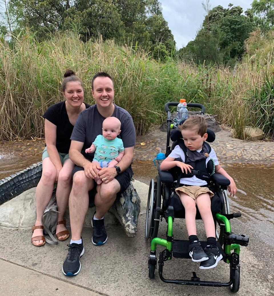 Alex Petronijevic in a wheelchair, parents Bess and Mitch, and a baby sibling.