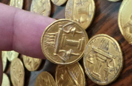 Gold coins excavated in Wasit province, south of Baghdad, are displayed on January 7, 2013