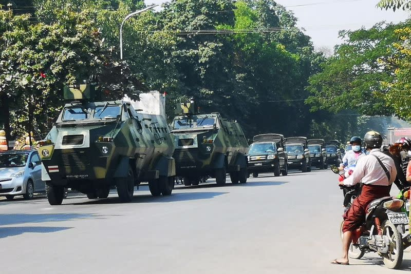 Myanmar Army armored vehicles drive past a street after they seized power in a coup in Mandalay