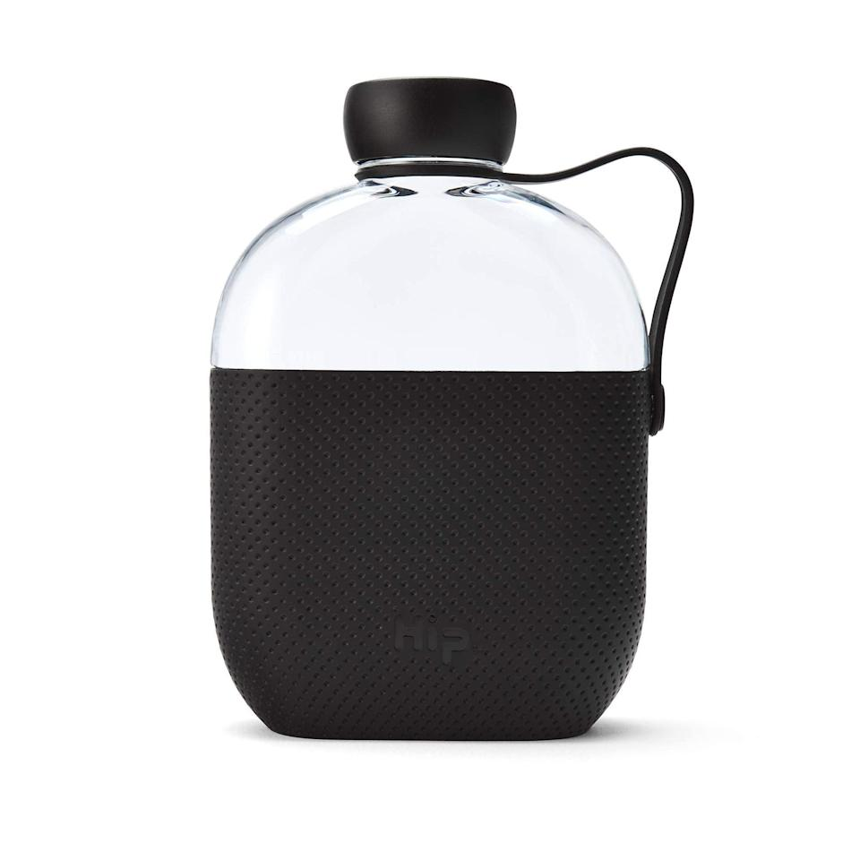 """<h2>Hip BPA-Free Water Bottle Flask With Silicone Sleeve </h2><br>Bringing a reusable water bottle when traveling may already be a no-brainer, but this chic flask design takes it to the next convenience level with BPA-free shatter-proof plastic, soft silicone sleeve, and flat packable design.<br><br><em>Shop</em> <strong><em><a href=""""https://amzn.to/3bnGngQ"""" rel=""""nofollow noopener"""" target=""""_blank"""" data-ylk=""""slk:Hip"""" class=""""link rapid-noclick-resp"""">Hip</a></em></strong><br><br><strong>Hip</strong> 22 oz. Plastic Water Bottle with Silicone Sleeve, $, available at <a href=""""https://amzn.to/3fkNW9m"""" rel=""""nofollow noopener"""" target=""""_blank"""" data-ylk=""""slk:Amazon"""" class=""""link rapid-noclick-resp"""">Amazon</a>"""