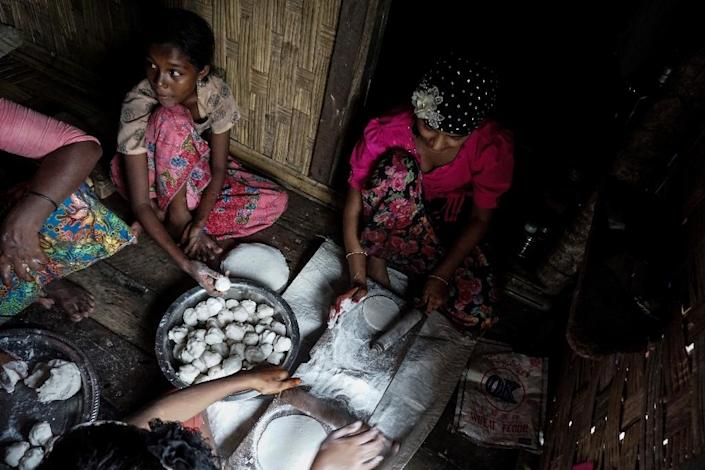Food being prepared at an Internally Displaced Persons (IDPs) camp in Rakhine State, where the World Food Programme has now suspended aid (AFP Photo/STR)