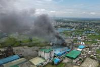 Smoke continued to rise from the factory the day after the blaze broke out