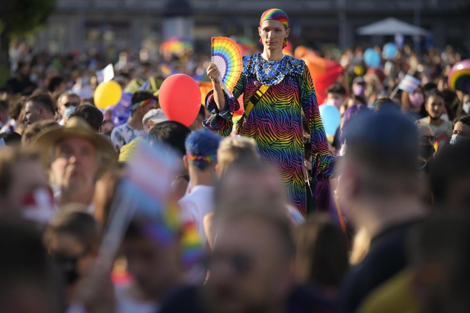 A person wears rainbow colors during the Bucharest Pride 2021 in Bucharest, Romania, Saturday, Aug. 14, 2021. The 20th anniversary of the abolishment of Article 200, which authorized prison sentences of up to five years for same-sex relations, was one cause for celebration during the gay pride parade and festival held in Romania's capital this month. People danced, waved rainbow flags and watched performances at Bucharest Pride 2021, an event that would have been unimaginable a generation earlier. (AP Photo/Vadim Ghirda)