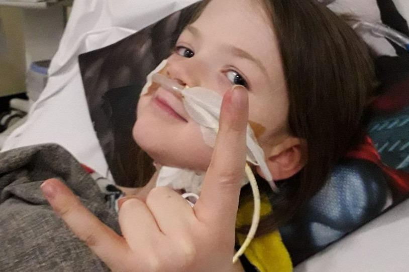 Kori Parkin-Stovell, eight, is critically ill in hospital (Picture: GoFundMe)
