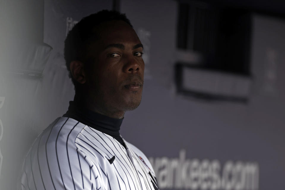 New York Yankees relief pitcher Aroldis Chapman looks on from the dugout during the seventh inning of the first baseball game of a doubleheader against the New York Mets on Sunday, July 4, 2021, in New York. (AP Photo/Adam Hunger)