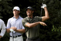 Tiger Woods tees off on the 14th hole as Andy Ogletree watches during the first round of the Masters golf tournament Thursday, Nov. 12, 2020, in Augusta, Ga. (Curtis Compton/Atlanta Journal-Constitution via AP)