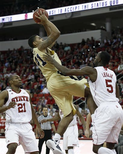 North Carolina State's C.J. Williams (21) and C.J. Leslie (5) guard Georgia Tech's Glen Rice Jr. during the first half of an NCAA college basketball game in Raleigh, N.C., Wednesday, Jan. 11, 2012. (AP Photo/Gerry Broome)
