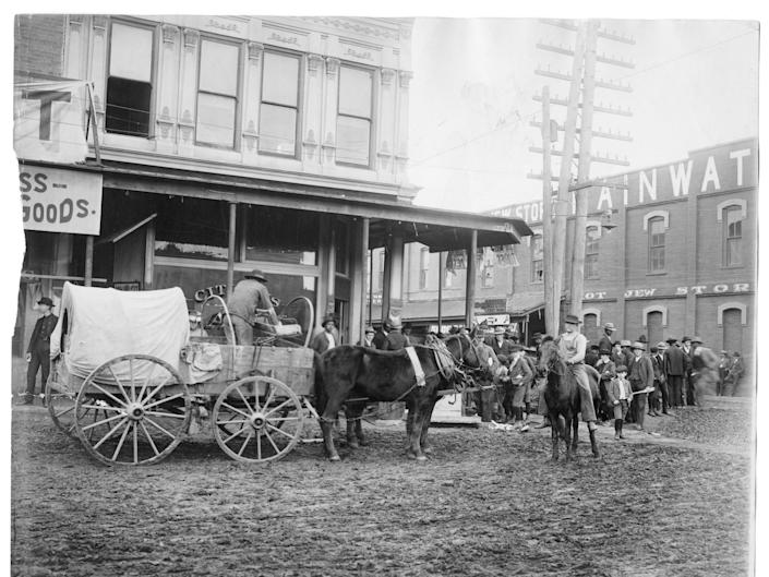 A horse drawn wagon in a small town in Arkansas in 1903.