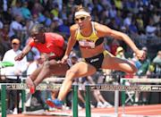 Lolo Jones clears a hurdle during the first round of the Women's 100 meter hurdles during the 2011 USA Outdoor Track & Field Championships at Hayward Field on June 25, 2011 in Eugene, Oregon. (Photo by Andy Lyons/Getty Images)