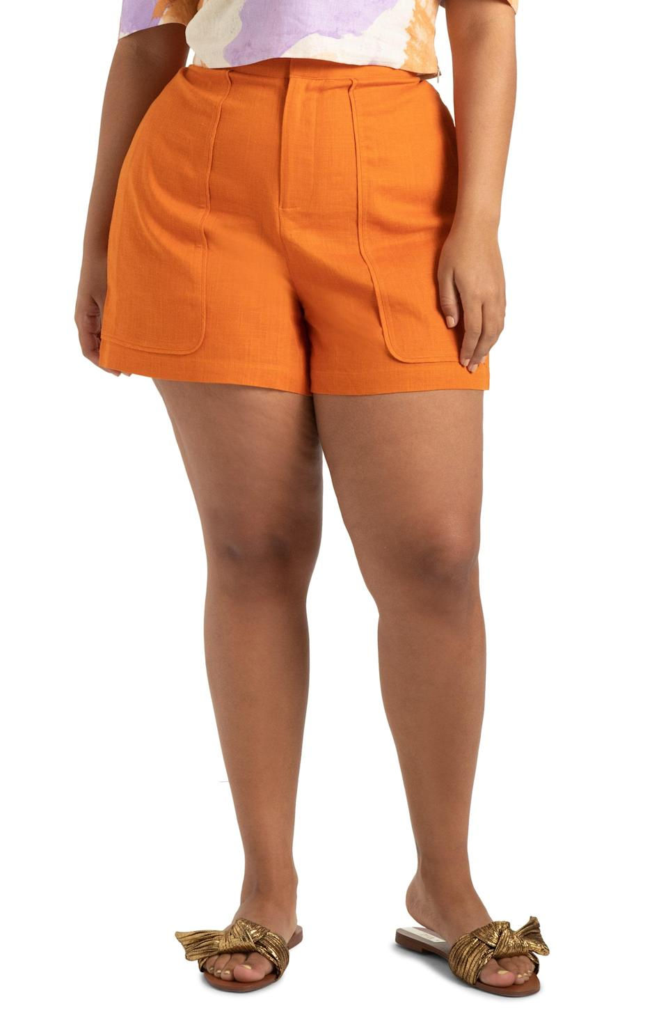 """<p><strong>ELOQUII</strong></p><p>nordstrom.com</p><p><strong>$38.98</strong></p><p><a href=""""https://go.redirectingat.com?id=74968X1596630&url=https%3A%2F%2Fwww.nordstrom.com%2Fs%2Feloquii-high-waist-shorts-plus-size%2F5903617&sref=https%3A%2F%2Fwww.thepioneerwoman.com%2Ffashion-style%2Fg36608512%2Fbest-high-waisted-shorts%2F"""" rel=""""nofollow noopener"""" target=""""_blank"""" data-ylk=""""slk:Shop Now"""" class=""""link rapid-noclick-resp"""">Shop Now</a></p><p>How gorgeous is this orange hue? It's called Hawaiian Sunset and it gives us instant vacation vibes. This plus-size pair features a tailored silhouette, roomy front patch pockets, and a back elastic waist for a just-right fit. </p>"""