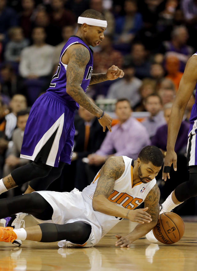 Sacramento Kings' Isaiah Thomas, left, chases down a loose ball with Phoenix Suns' Markieff Moris during the first half of an NBA basketball game on Friday, Dec. 13, 2013, in Phoenix. (AP Photo/Matt York)
