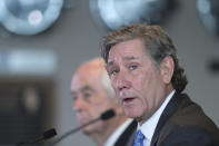 Hulman & Co. Chairman Tony Hulman George speaks during a news conference at Indianapolis Motor Speedway in Indianapolis Monday, Nov. 4, 2019. Indianapolis Motor Speedway and the IndyCar Series were sold to Penske Entertainment Corp. in a stunning move Monday that relinquishes control of the iconic speedway from the Hulman family after 74 years. In the background is Roger Penske. (AP Photo/AJ Mast)