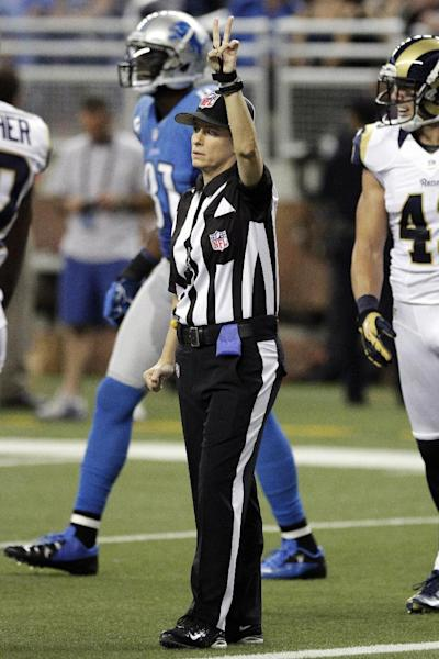 Line judge Shannon Eastin signals second down in front of Detroit Lions wide receiver Calvin Johnson (81) and St. Louis Rams strong safety Craig Dahl (43) during the second quarter of an NFL football game, Sunday, Sept. 9, 2012 in Detroit. (AP Photo/Duane Burleson)