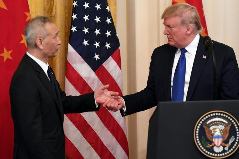 US President Donald Trump, shakes hands with China's Vice Premier Liu He, the country's top trade negotiator, before they sign a trade agreement