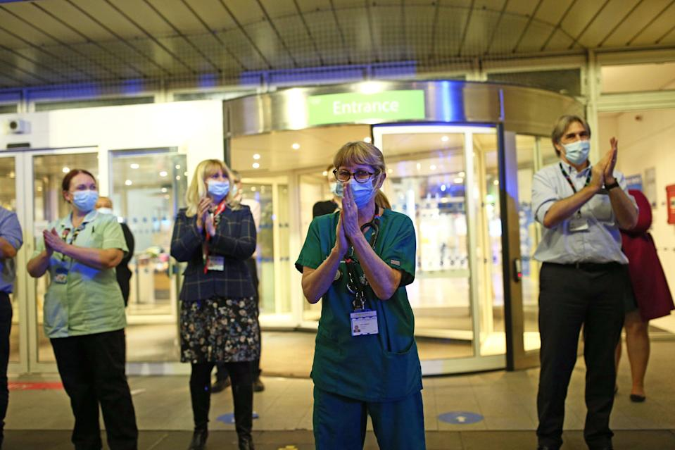 <p>NHS staff outside the Chelsea and Westminster Hospital in London</p> (PA)